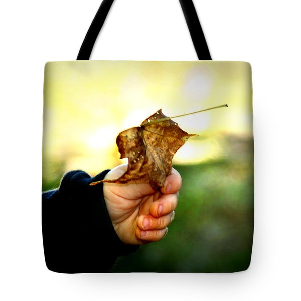 Tote Bag featuring the photograph Autumn In Hand by Kelly Hazel