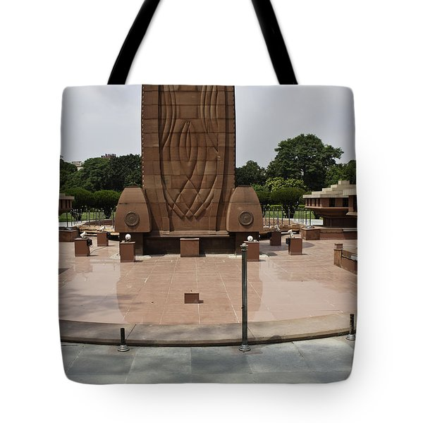Tote Bag featuring the photograph Base Of The Jallianwala Bagh Memorial In Amritsar by Ashish Agarwal