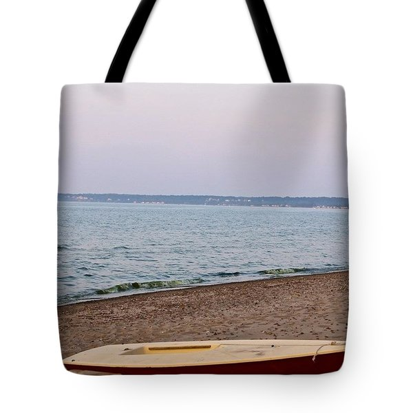beached red Sailboat Tote Bag