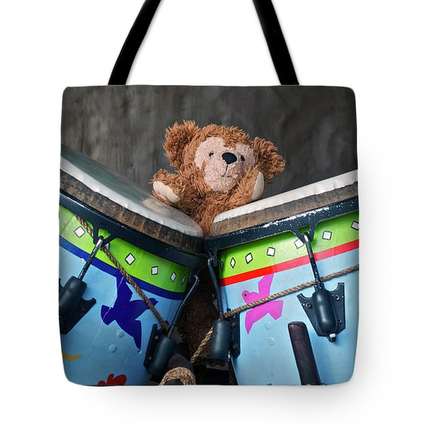 Tote Bag featuring the photograph Bear And His Drums At Walt Disney World by Thomas Woolworth