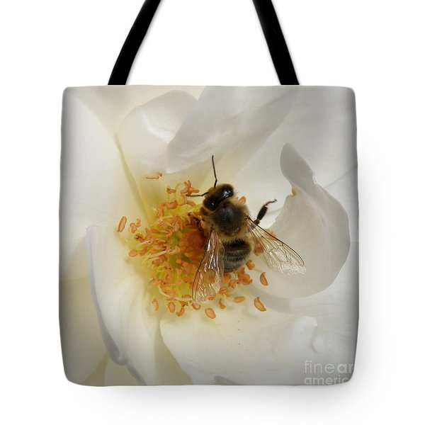 Tote Bag featuring the photograph Bee In A White Rose by Lainie Wrightson