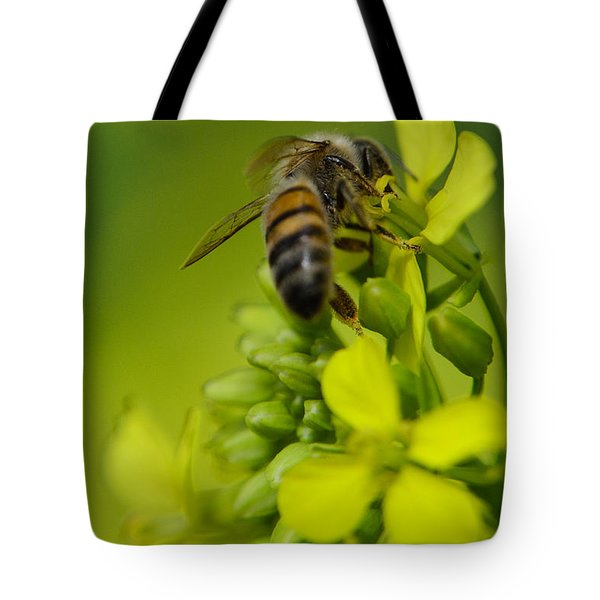 Tote Bag featuring the photograph Bee On A Yellow Background by Michael Goyberg