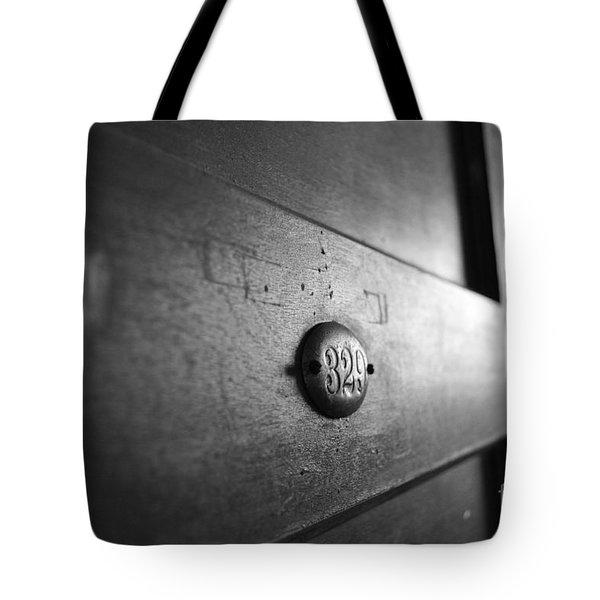 Behind Door No. 329 Tote Bag by Luke Moore