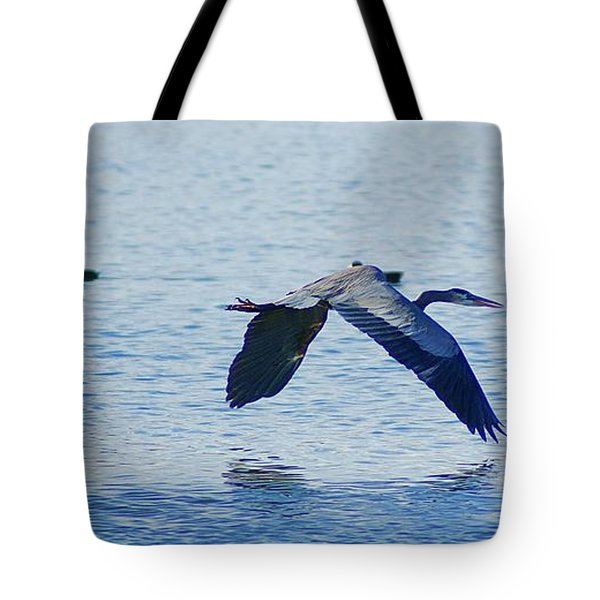 Tote Bag featuring the photograph Big Blue Heron Flying Away From Me by John  Kolenberg