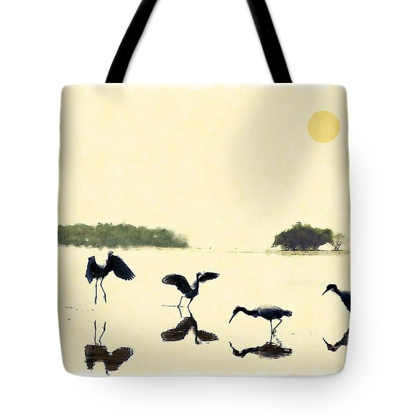Tote Bag featuring the photograph birds feeding in the Everglades by Dan Friend