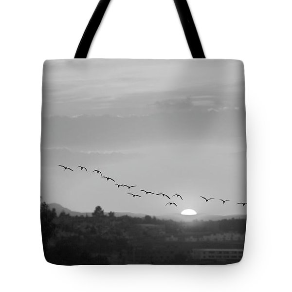 Tote Bag featuring the digital art Birds Flying Into The Sunset by John  Kolenberg