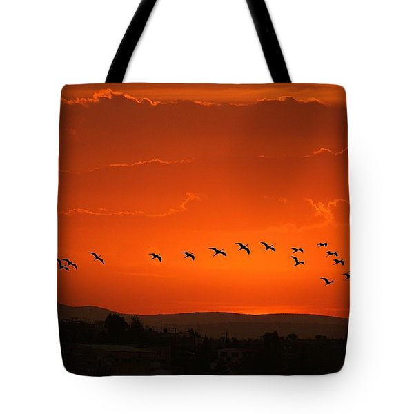 Tote Bag featuring the digital art Birds In A Crimson Sunset by John  Kolenberg