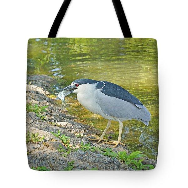 Blue Heron With Fish Tote Bag by J Jaiam