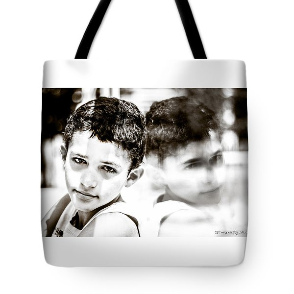 Tote Bag featuring the photograph Blurred Thoughts by Stwayne Keubrick