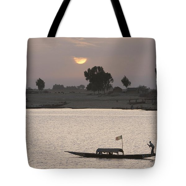 Boat On The Niger River In Mopti, Mali Tote Bag by Peter Langer