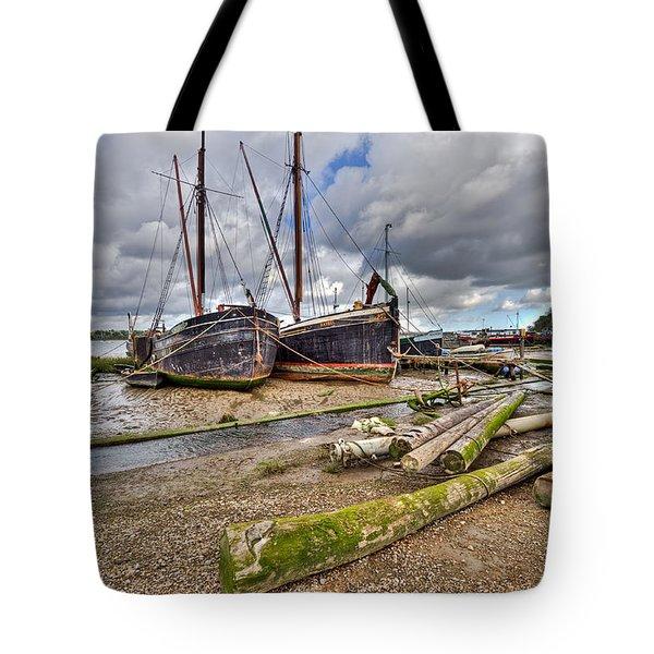 Boats And Logs At Pin Mill Tote Bag by Gary Eason