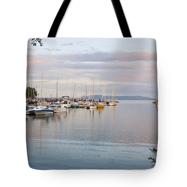 Boats In The Harbour At Sunset Thunder Tote Bag by Susan Dykstra