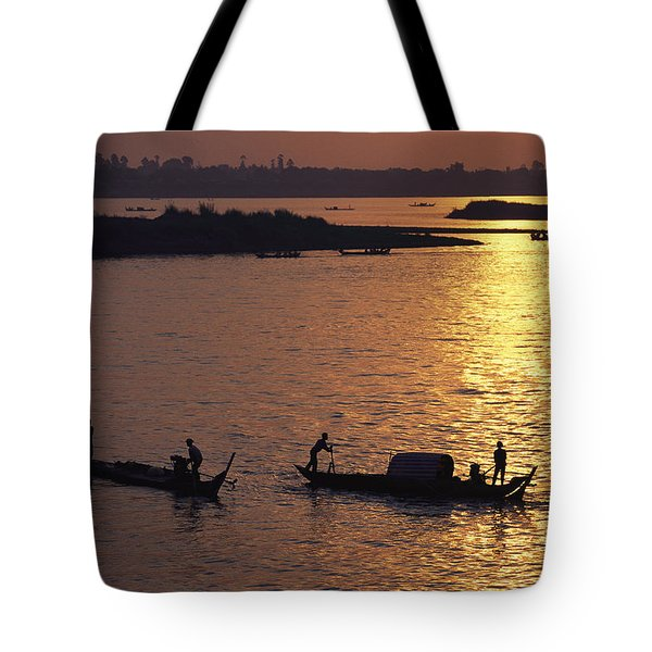 Boats Silhouetted On The Mekong River Tote Bag by Steve Raymer