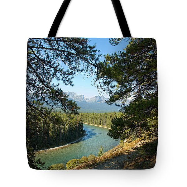 Tote Bag featuring the photograph Bow River by Bob and Nancy Kendrick