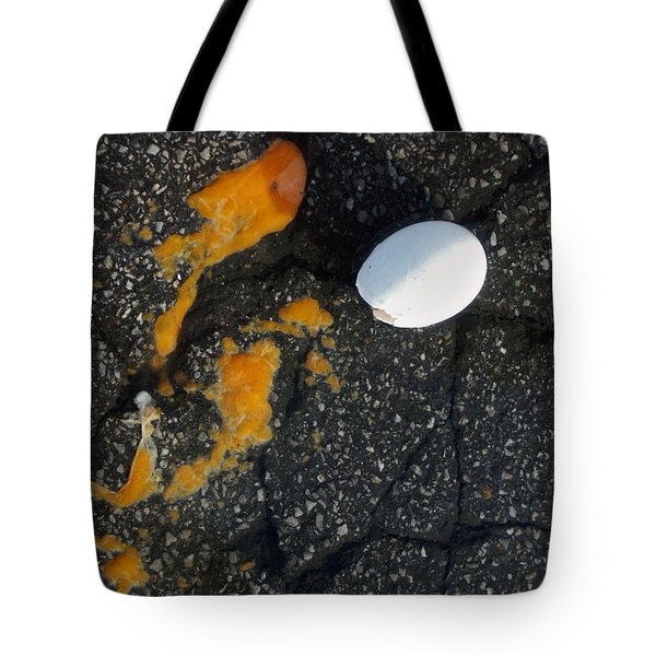 Broken White Egg And Orange Yolk On Black Ground Tote Bag by Matthias Hauser
