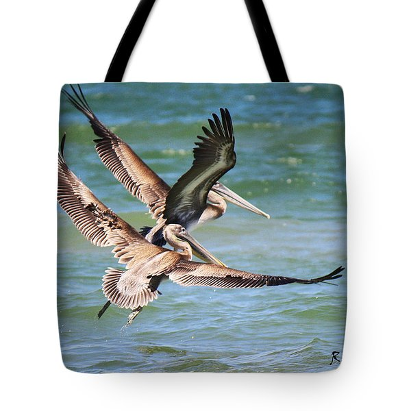 Brown Pelicans Taking Flight Tote Bag
