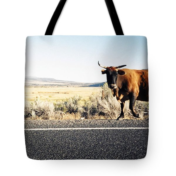 Bull On The Road Tote Bag by Peter Mooyman