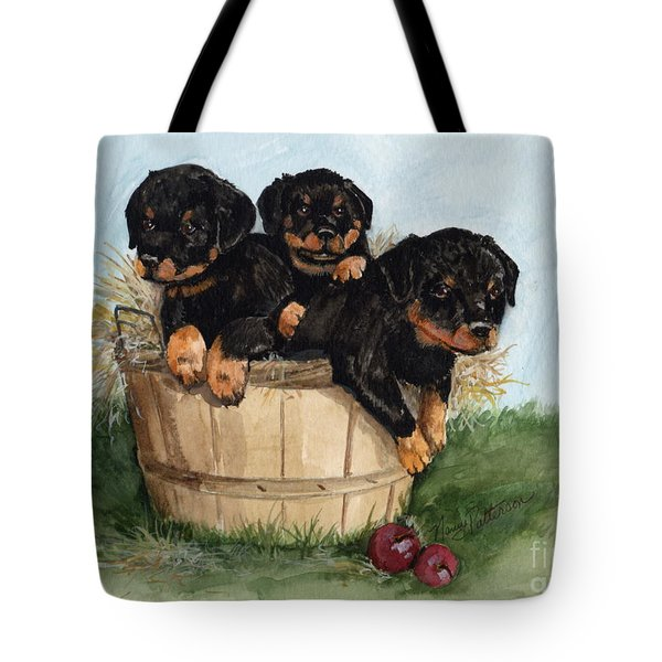 Tote Bag featuring the painting Bushel Of Rotty Pups  by Nancy Patterson