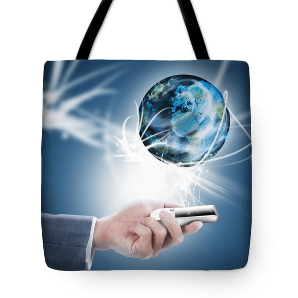 Businessman Holding Mobile Phone With Globe Tote Bag