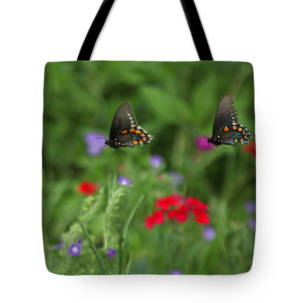 Tote Bag featuring the photograph Butterfly Chase by Susan Rovira