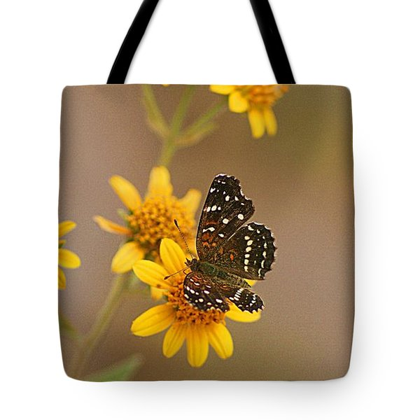 Tote Bag featuring the digital art Butterfly On Marigold by John  Kolenberg