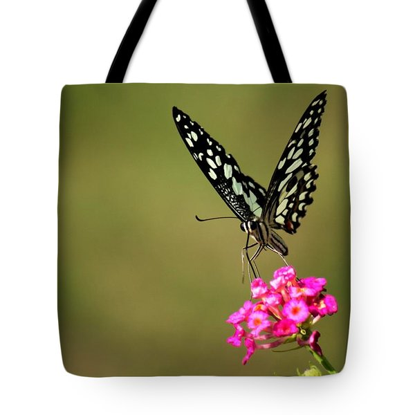 Tote Bag featuring the digital art Butterfly On Pink Flower  by Ramabhadran Thirupattur