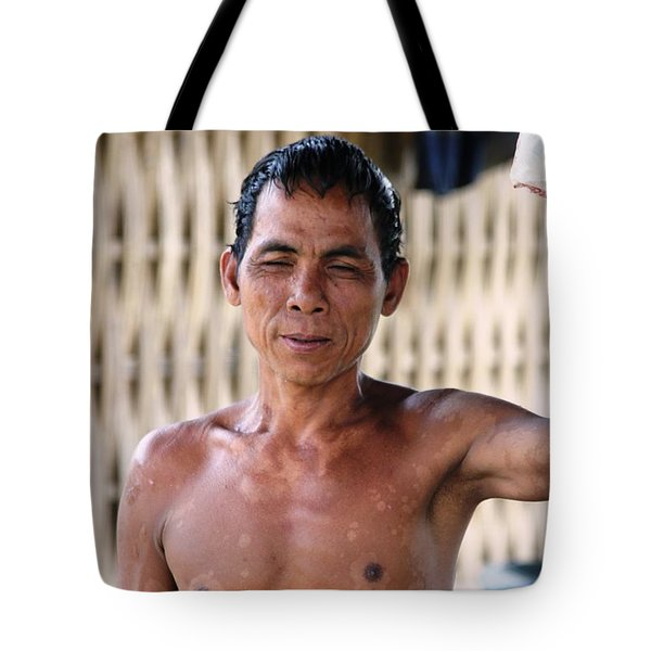 Tote Bag featuring the photograph Cambodian Dignity by Nola Lee Kelsey