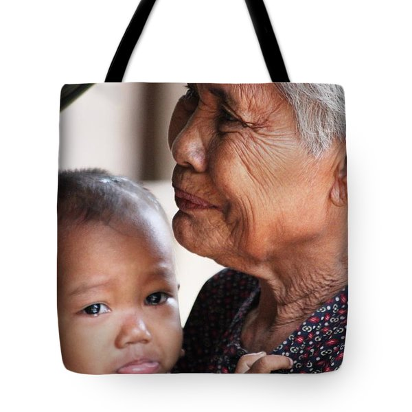Tote Bag featuring the photograph Cambodian Grandmother And Baby #1 by Nola Lee Kelsey