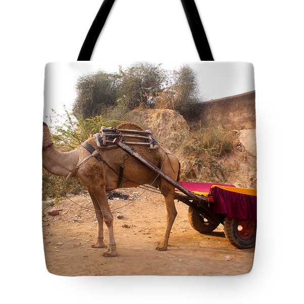 Tote Bag featuring the photograph Camel Yoked To A Decorated Cart Meant For Carrying Passengers In India by Ashish Agarwal