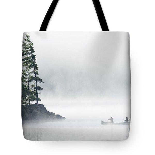 Canoeing Through Fog On Lake Of Two Tote Bag by Mike Grandmailson