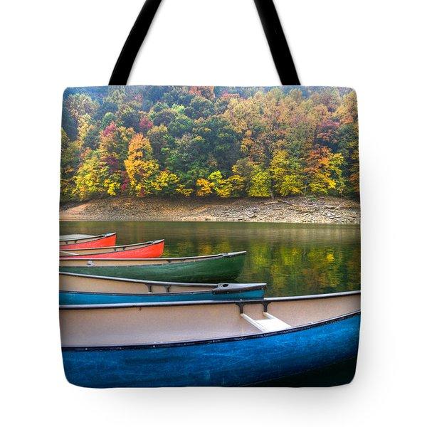 Canoes At Fontana Tote Bag by Debra and Dave Vanderlaan
