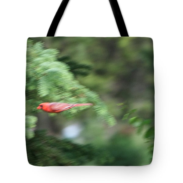 Tote Bag featuring the photograph Cardinal In Flight by Thomas Woolworth