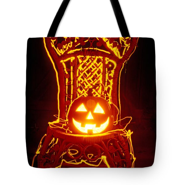 Carved Smiling Pumpkin On Chair Tote Bag by Garry Gay