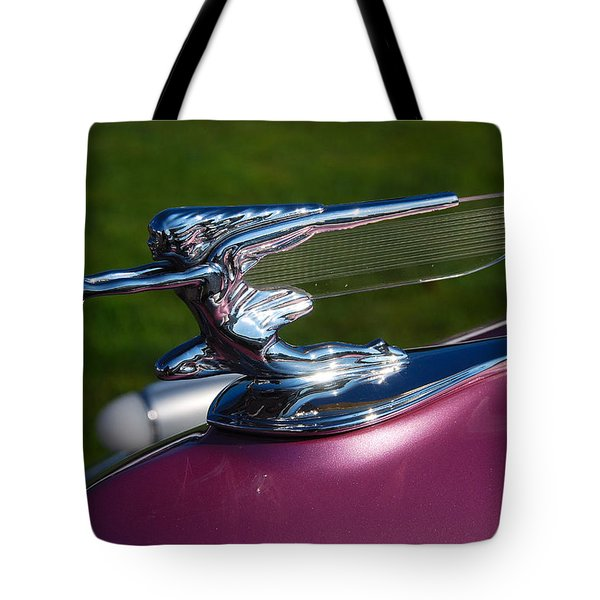 Tote Bag featuring the photograph Chasing The Donut by John Schneider