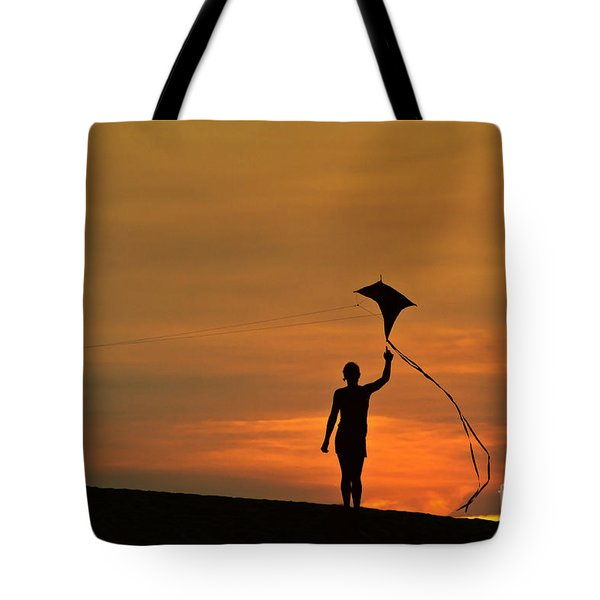 Child Flying A Kite Tote Bag
