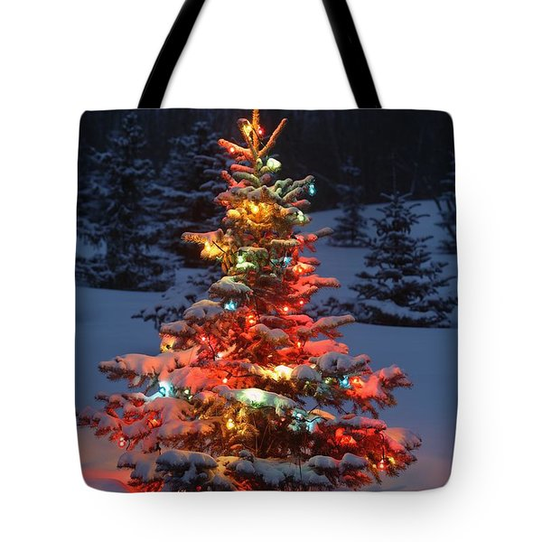 Christmas Tree With Lights Outdoors In Tote Bag by Carson Ganci