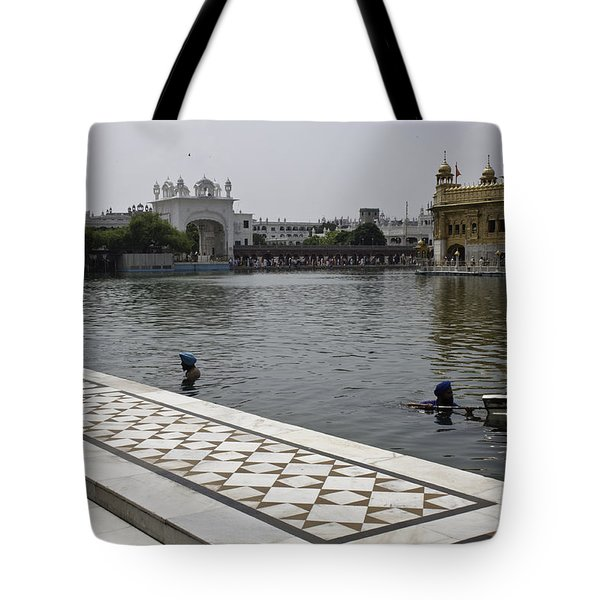 Tote Bag featuring the photograph Clearing The Sarovar Inside The Golden Temple Resorvoir by Ashish Agarwal