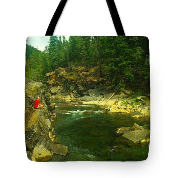 Cliff Over The Yak River Tote Bag by Jeff Swan
