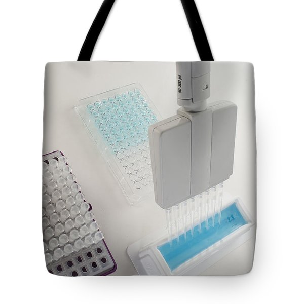 Close Up Of Liquid Aspiration With An Tote Bag by Greg Dale