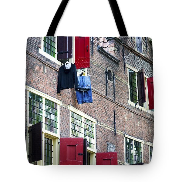Clothes Hanging From A Window In Kattengat Tote Bag