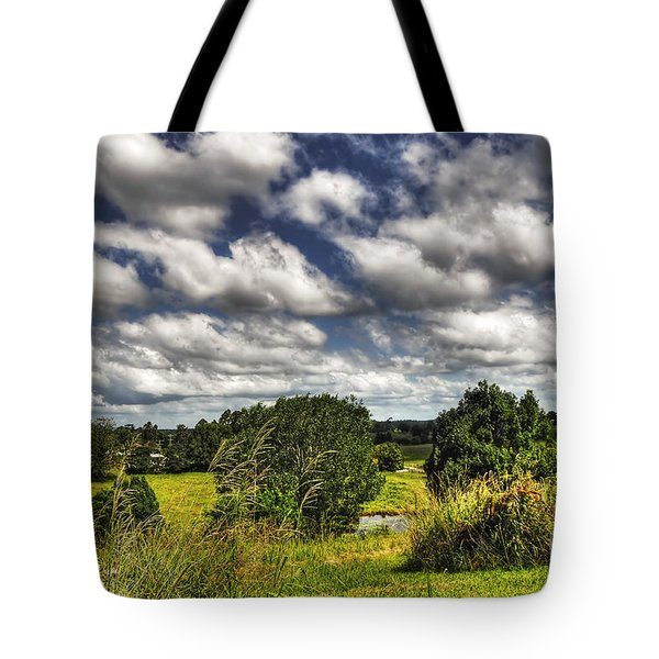 Clouds Floating Over Green Countryside Tote Bag by Kaye Menner