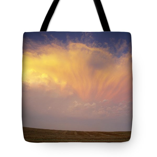 Clouds Over Canola Harvest, Saint Tote Bag by Yves Marcoux