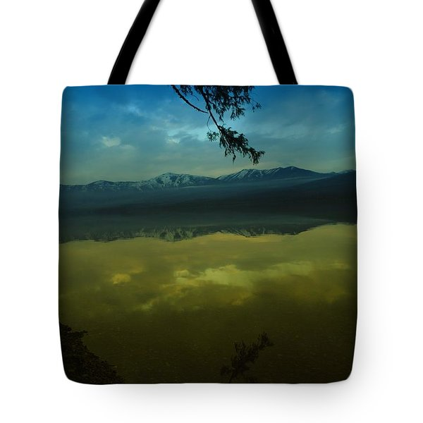 Clouds Trying To Dance In Still Water Tote Bag by Jeff Swan