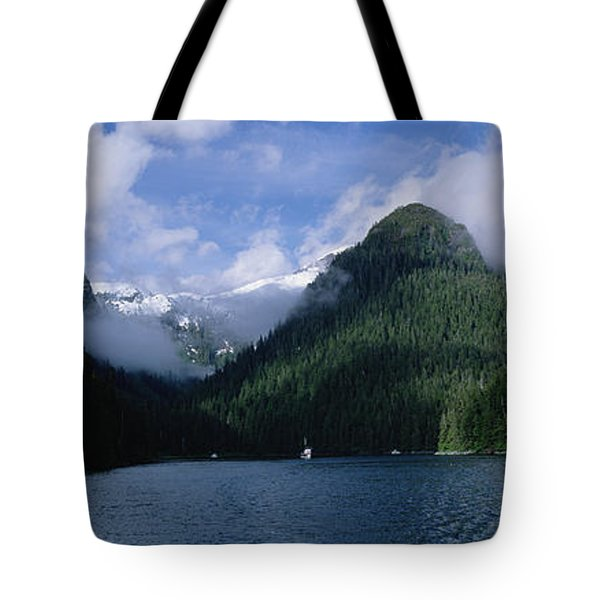 Conifer-covered Coastline Of Warm Tote Bag by Konrad Wothe