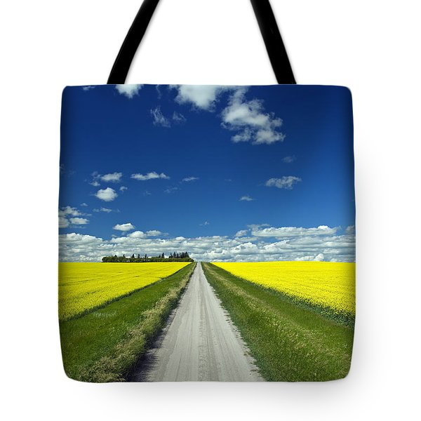 Country Road With Blooming Canola Tote Bag by Dave Reede