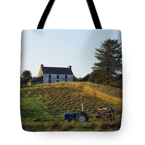 County Cork, Ireland Farmer On Tractor Tote Bag by Ken Welsh