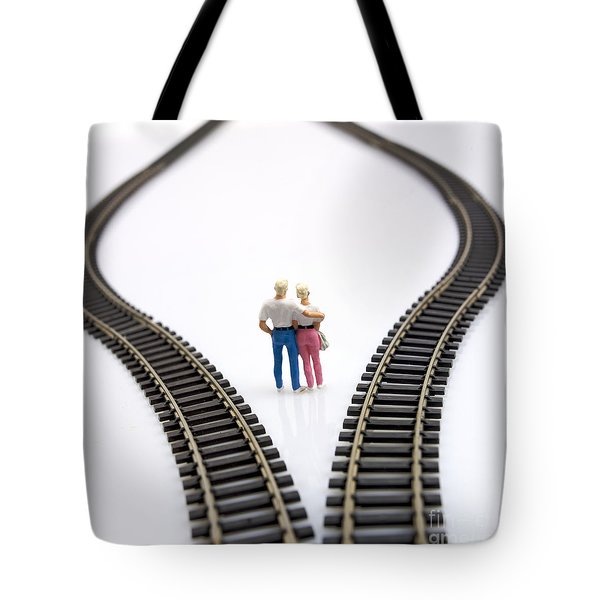 Couple Two Figurines Between Two Tracks Leading Into Different Directions Symbolic Image For Making Decisions Tote Bag