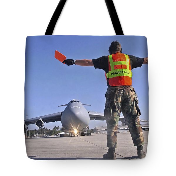 Crew Chief Marshals A C-5 Galaxy Tote Bag by Stocktrek Images