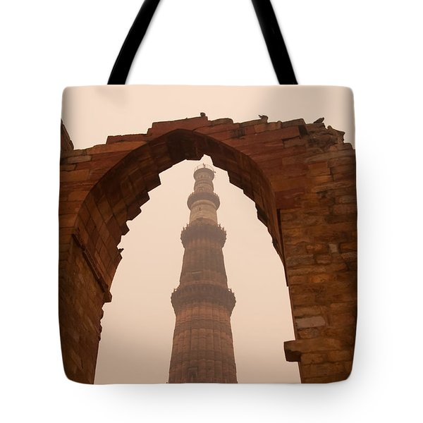 Cross Section Of The Qutub Minar Framed Within An Archway In Foggy Weather Tote Bag