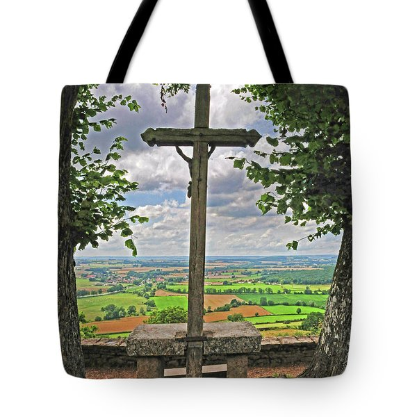 Tote Bag featuring the photograph Crucifix Overlooking The French Countryside by Dave Mills